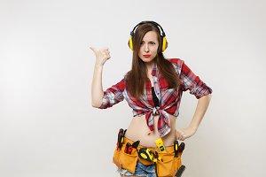 Woman in plaid shirt, denim shorts,