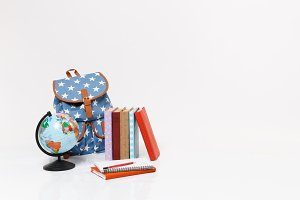 World globe, blue backpack with star