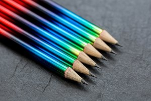 Colorful pencils on dark background