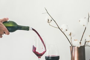 Red wine pouring from bottle into