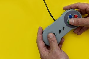 Man playing video game controller
