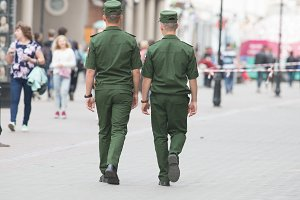 Two soldiers in uniform walking down