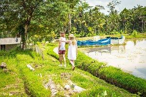 Young honeymoon couple walking among