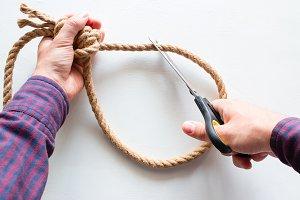 man cuts a loop