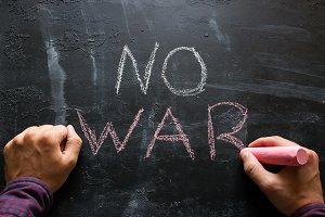 "man writes the text ""no war"""