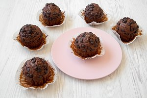 Chocolate muffins, side view.