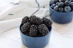 Berries in bowls on a white wooden