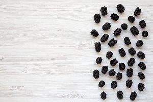 Blackberries on white wooden