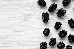 Blackberries on white wooden surface