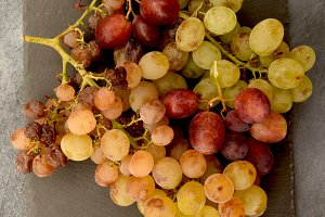 Bunches of grapes on slate stone