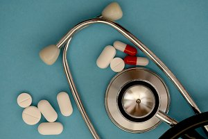 Used stethoscope and pharmacy pills