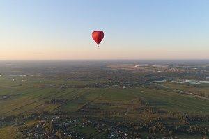 Hot air balloon shape heart in sky