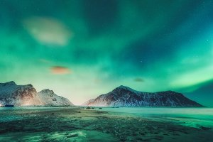 Northern lights above the rocks