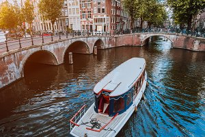 Tour boat at famous Dutch canal on a