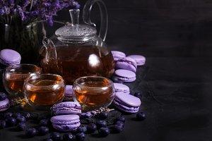 Lavander tea with macarons backgroun