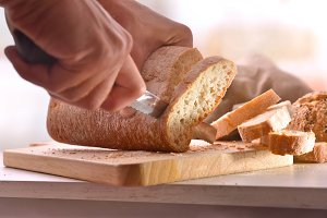 Chef slicing bread in slices