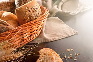 Basket with bread on fabric black