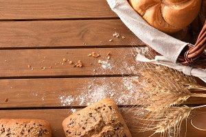 Assortment of breads over wicker top