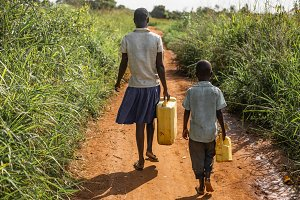 Two kids on a walk for clean water