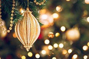 Xmas golden toy in bokeh lights