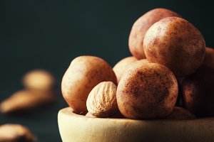 Marzipan, round almond candies in wo
