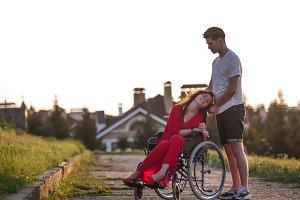 Girl in a wheelchair cute talking to