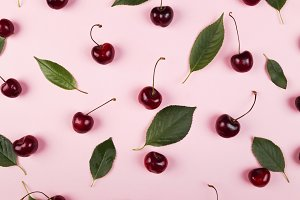 Ripe cherry and green leaves on a pi
