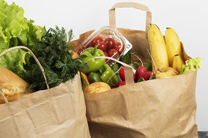 Various healthy food in paper bag on