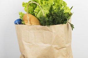 Various healthy food in paper bag on