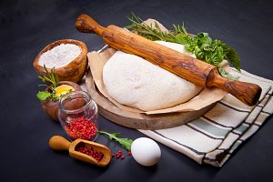 Wooden rolling pin with freshly prep