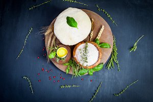 Pizza dough with egg, herbs and flou