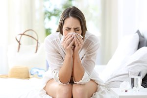 Ill woman coughing in an hotel