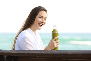Girl holding a green smoothie
