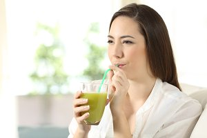 Girl drinking vegetable juice