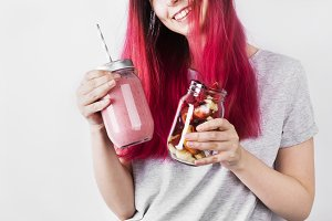 Young woman with pink hair drinks sm