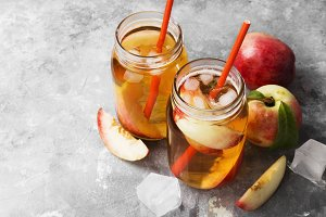 Peach ice tea on a gray background.