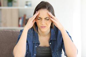 Woman complaining suffering migraine