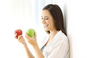 Smiley girl holding two apple
