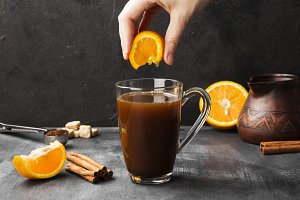 Autumn drink of coffee with orange j