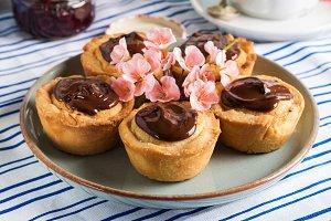 Cakes with frangipane, cherry jam an