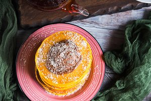 Pumpkin pancakes stack served with c