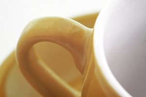 A yellow cup handle for tea or coffe