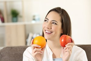 Woman wondering about fruits
