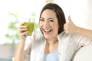 Woman holding a vegetable juice
