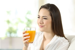 Woman holding a glass of juice