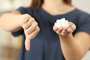 Woman hand holding sugar cubes