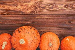 Pumpkinson rustic wood background