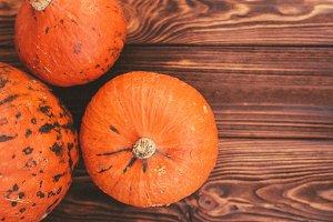 Pumpkins on a rustic wood table