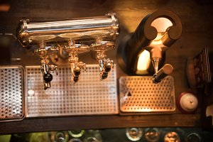 Shiny beer taps in the bar. View