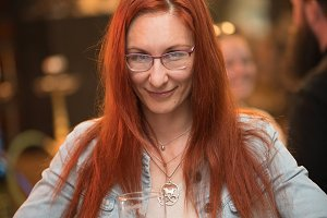 Red-haired young woman in glasses